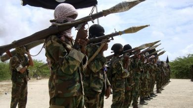 Photo of Two al-Shabab militants surrender to government forces in southern Somali
