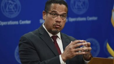 Photo of Attorney General Keith Ellison upgrade charges against officer who knelt on George Floyd's neck; charged other 3 involved
